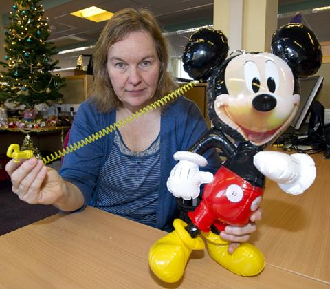 Principal Trading Standards Officer Colette Rai shows one of the hazardous balloon cords. The balloon featured in the photograph does not pose any safety threat.