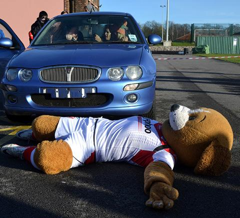 St Helens Star: Saints mascot Boots being rescued at the road collision demonstration at Cowley International College