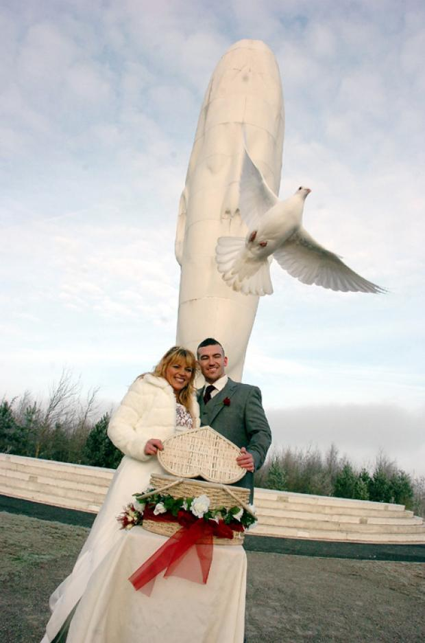Flying start to married life: Kerri and Lee Abbott celebrate their wedding at Dream. Photo: MIKE BODEN