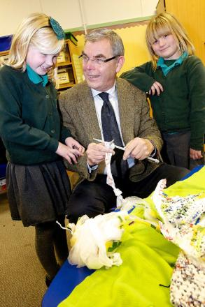 Councillor Joe DeAsha picks up some handy recycling skills from Lucy Ferguson, seven, and Angela Barker, eight.