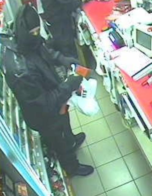 One of the robbers is captured in CCTV carrying the small axe..