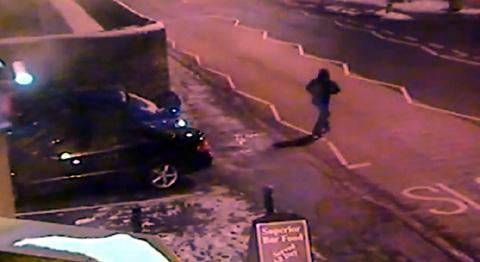 CCTV shows the hooded thief ditching the stolen Subaru outside the Billinge Arms before fleeing across Main Street.