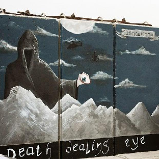 A hand painted mural from 662 Squadron on a prefabricated blast wall at Camp Bastion
