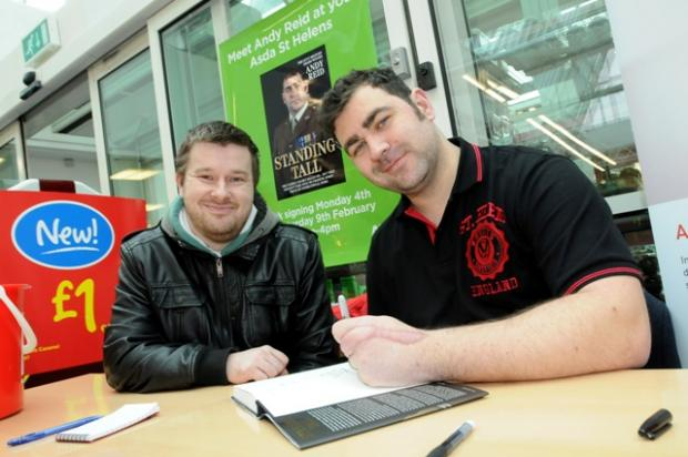 MY STORY: Andy Reid with Asda customer Shaun Allen.