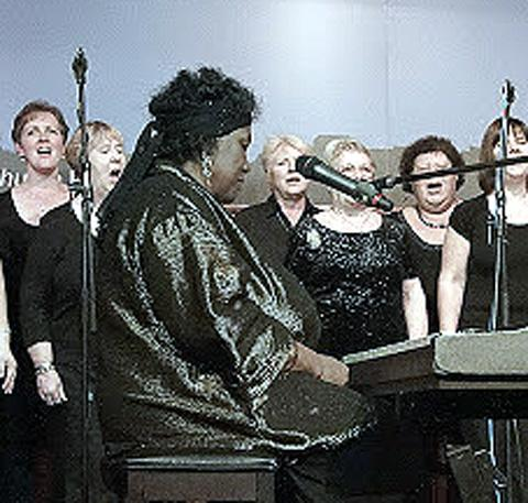 Members of the choir perform with Elsa Harris
