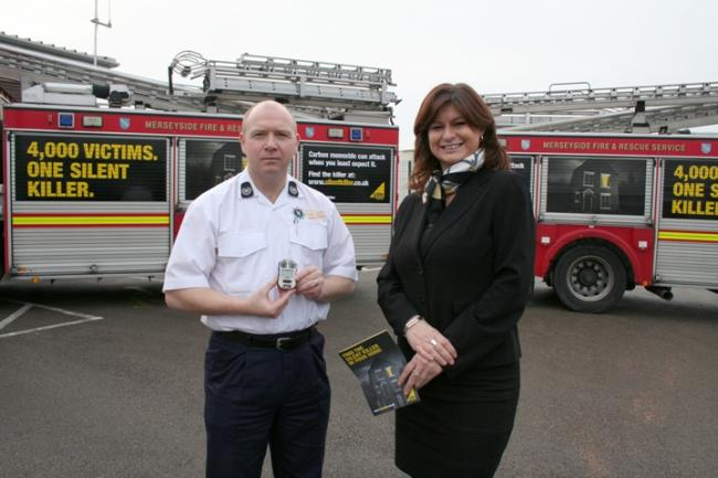 Group Manager Gary Oakford and Sarah Hill from Gas Safe Register at the launch of the awareness imagery on the fire appliances.