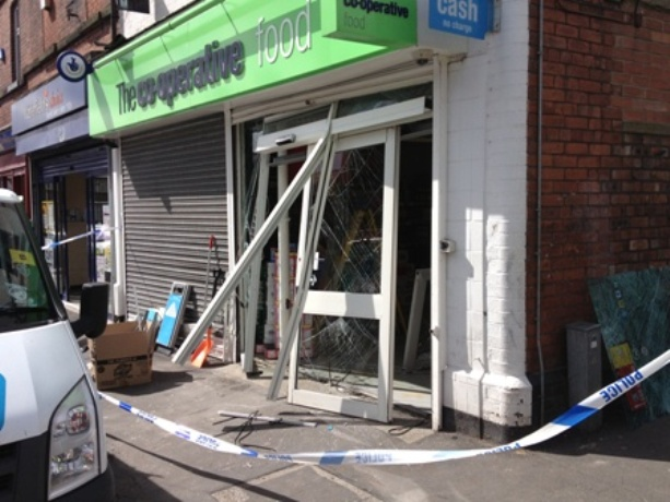 Smash and grab: The scene at the Co-Op store on Cambridge Road.