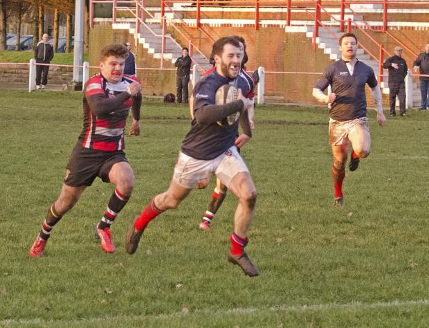 St Helens Star: Greg Smith runs in for LSH's fourth try. Picture: Colin Douglas