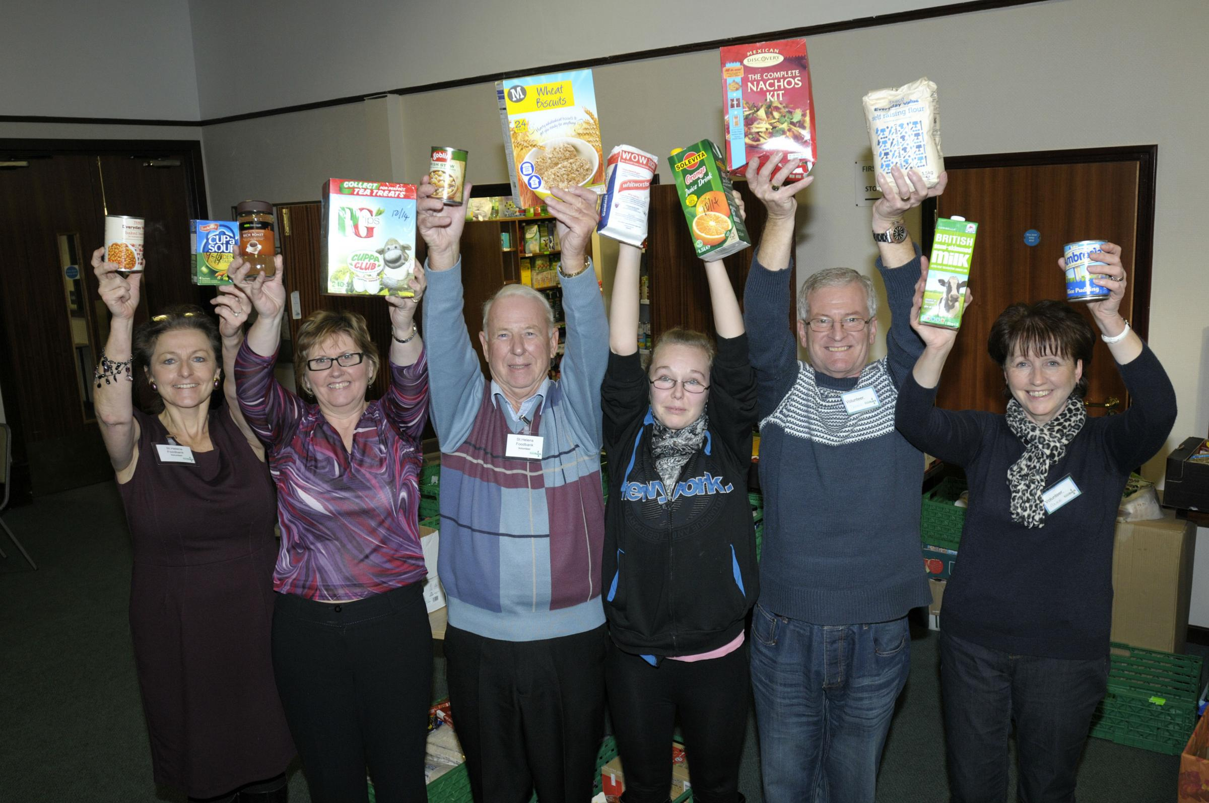 Food bank crews marked St Helens first anniversary this winter... and their supplies are being stocked by library users