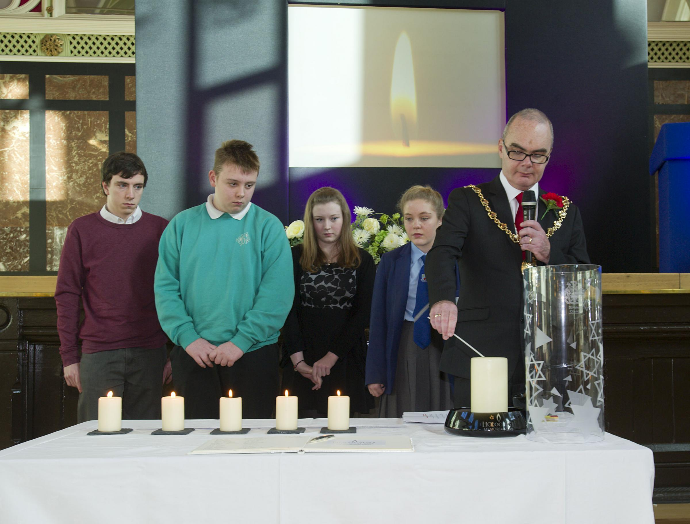 Mayor Cllr Andy Bowden with students at the Holocaust commemoration event at the town hall.