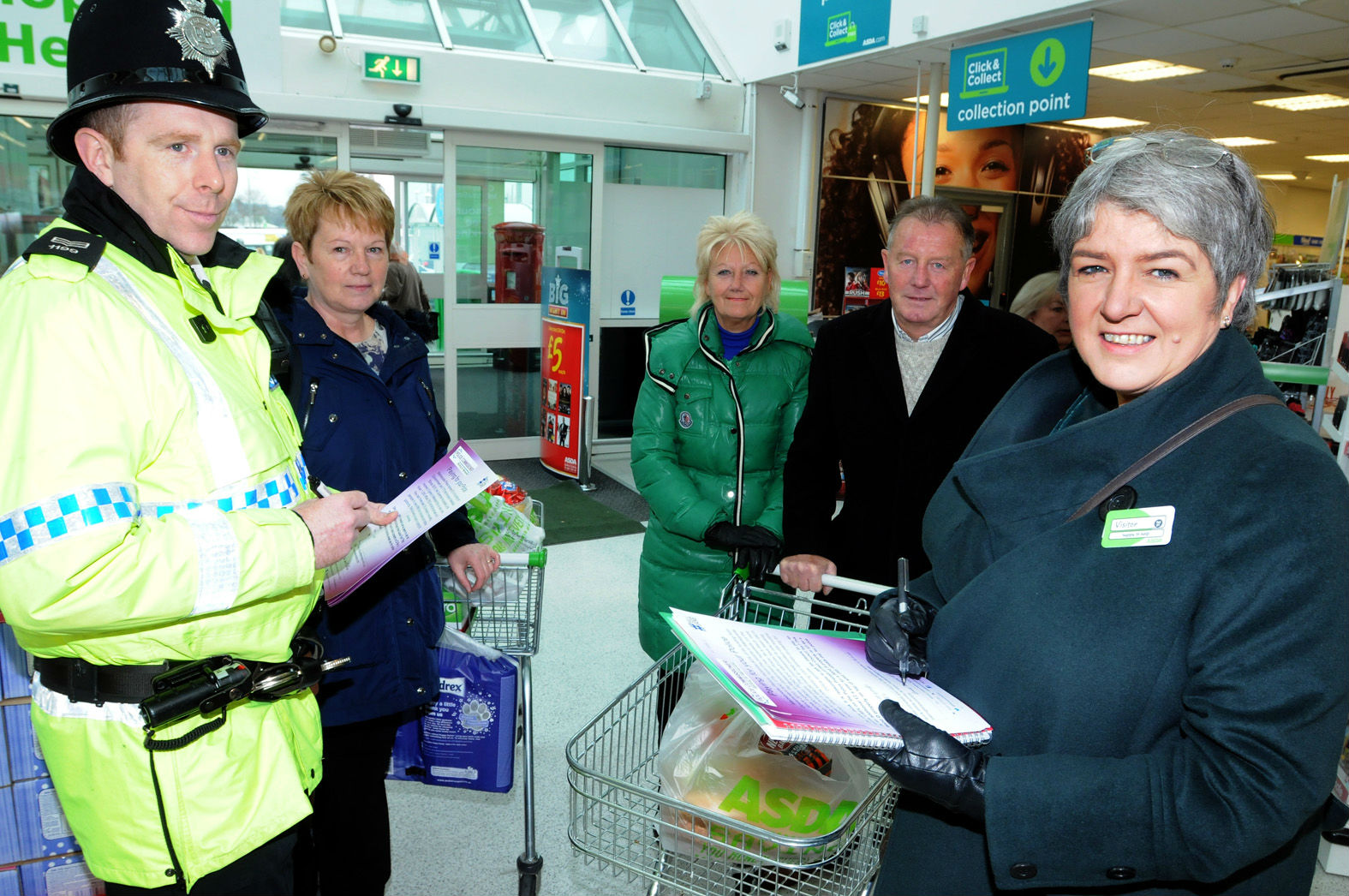 Police Commissioner Jane Kennedy, right, with Sergeant Neil Birkett and shoppers at Asda seeking their views on increasing the police precept