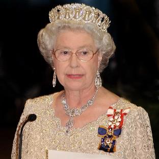 St Helens Star: The Queen welcomed famous names such as John Hurt, Sir Roger Moore and Joan Collins to Buckingham Palce