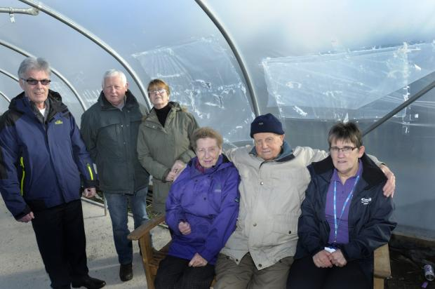 St Helens Star: Stroke survivors and carers survey the polytunnel damage with Stroke Association co-ordinator Jean Hobbs.