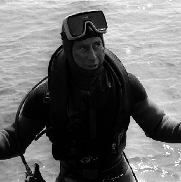 St Helens Star: The Prince of Wales surfaces after a dive to visit the wreck of the Mary Rose.