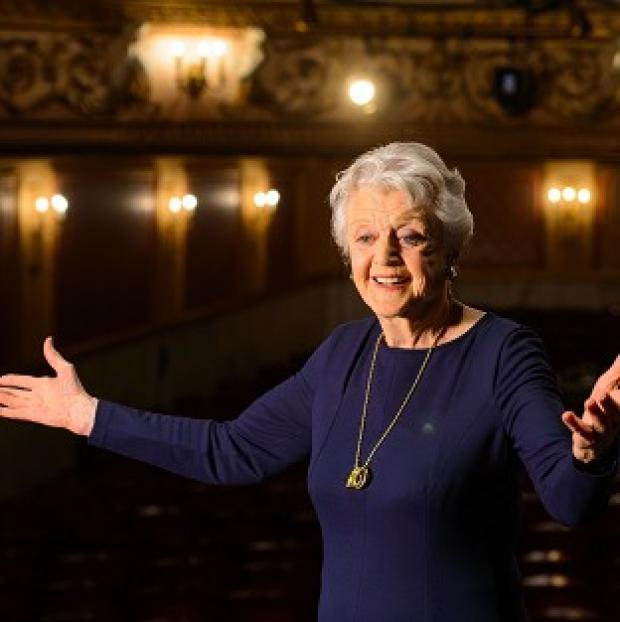 St Helens Star: Actress Dame Angela Lansbury onstage during a photocall at the Gielgud Theatre, in central London, where she will play the role of Madam Arcati in a new production of 'Blithe Spirit', her first West End role in almost 40 years.