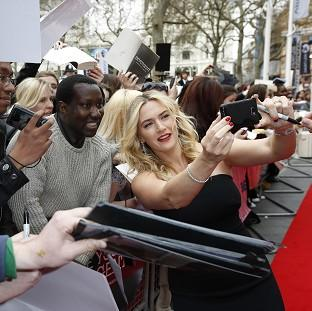 St Helens Star: Kate Winslet poses for pictures with fans at the European premiere of the film, Divergent, at the Odeon Leicester Square, central London.