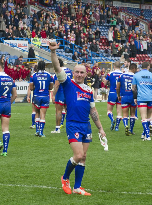 St Helens Star: CUP hero Luke Walsh salutes the army of Saints supporters at the end of Sunday's dramatic win at Huddersfield Giants. On his comeback from injury, the scrum half landed the winning drop goal to send Saints marching into the fifth round. Pic Bernard Plat