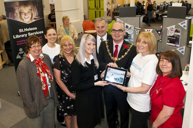 St Helens Star: Sue Williamson, pictured far left, at the offiicial e-book launch today, with library staff and guests including the Mayor of St Helens Andy Bowden