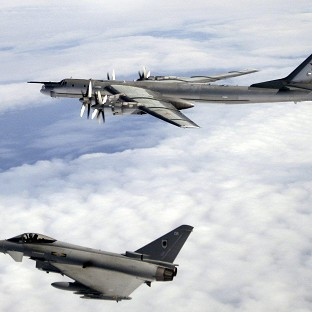 RAF Typhoons (below) were sent to monitor Russian aircraft.