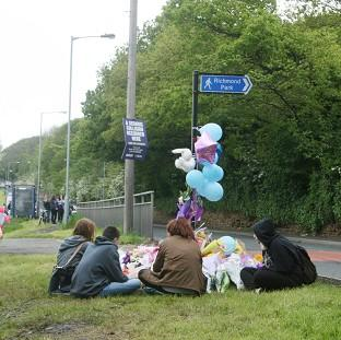 St Helens Star: Friends of Jasmyn Chan hold a vigil near to the scene where the 14-year-old died following a hit-and-run collision in Sheffield