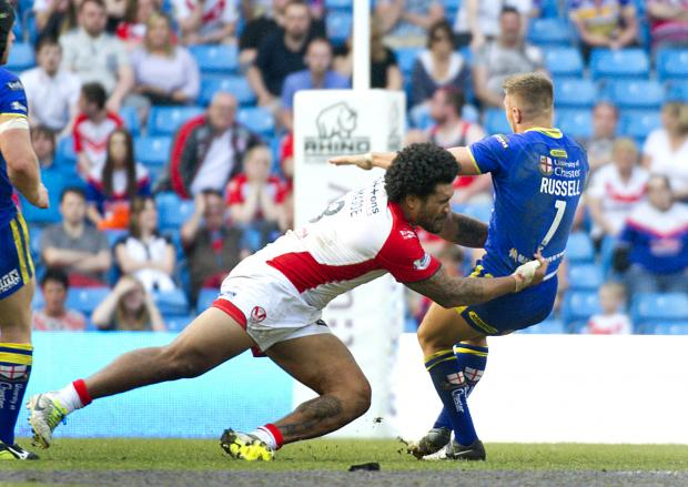 St Helens Star: Mose masoe makes a big tackle on Matty Russell