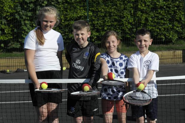 St Helens Star: Budding tennis aces: Hollie Carr, John Carr, Amelie Roberts and Matthew Carter have been learning raquet skills on the park's courts