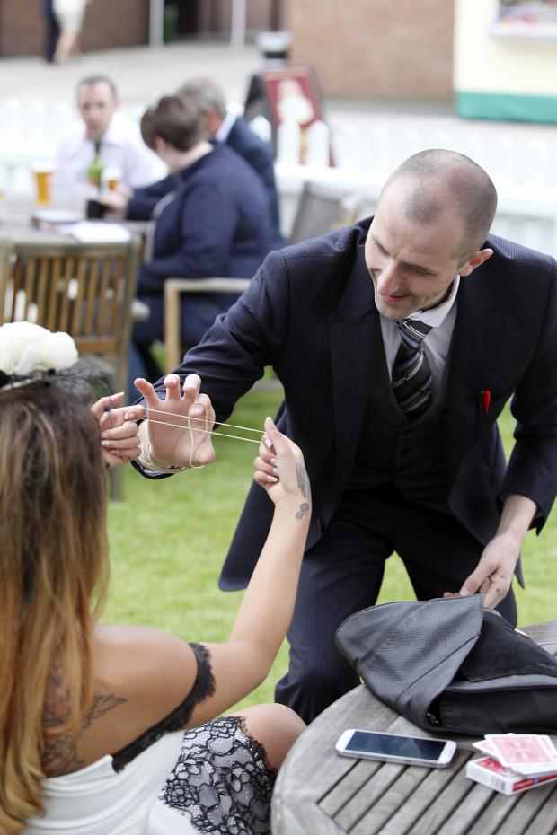 St Helens Star: TRICKS: Jay the Magician from Them Management entertaining the crowds at Haydock Park (tricks)