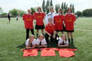 Members of the Cowley Girls' football team receive their Liverpool FC playing kit for from Nicole Rolser
