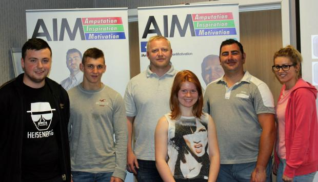 Andy Reid and Stephen Cruse of AIM with students studying Public and Uniformed Services at St Helens College