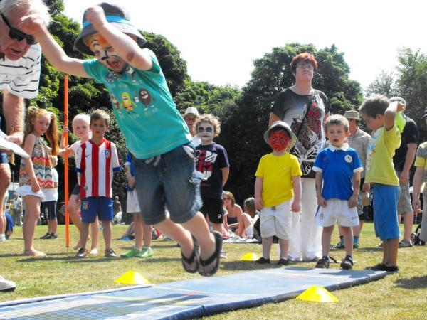 Hold that tiger! Children line-up for a jumping challenge at Moss Bank.