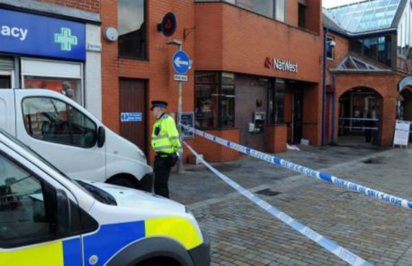 Police at the scene of one the incidents in Prescot (Picture courtesy Liverpool Echo)