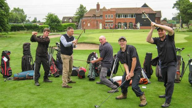Getting in full swing: Richard Burbidge (second from left) and staff at Eccleston Park Golf Club with donated golf equipment