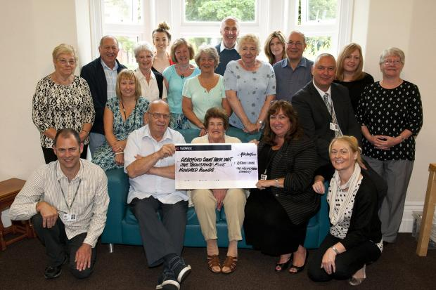 Kindness: Helen Marie's parents Arthur and Marjorie present the cheque to Councillor Sue Murphy, watched by committee members of the charity and staff from Abbeyford