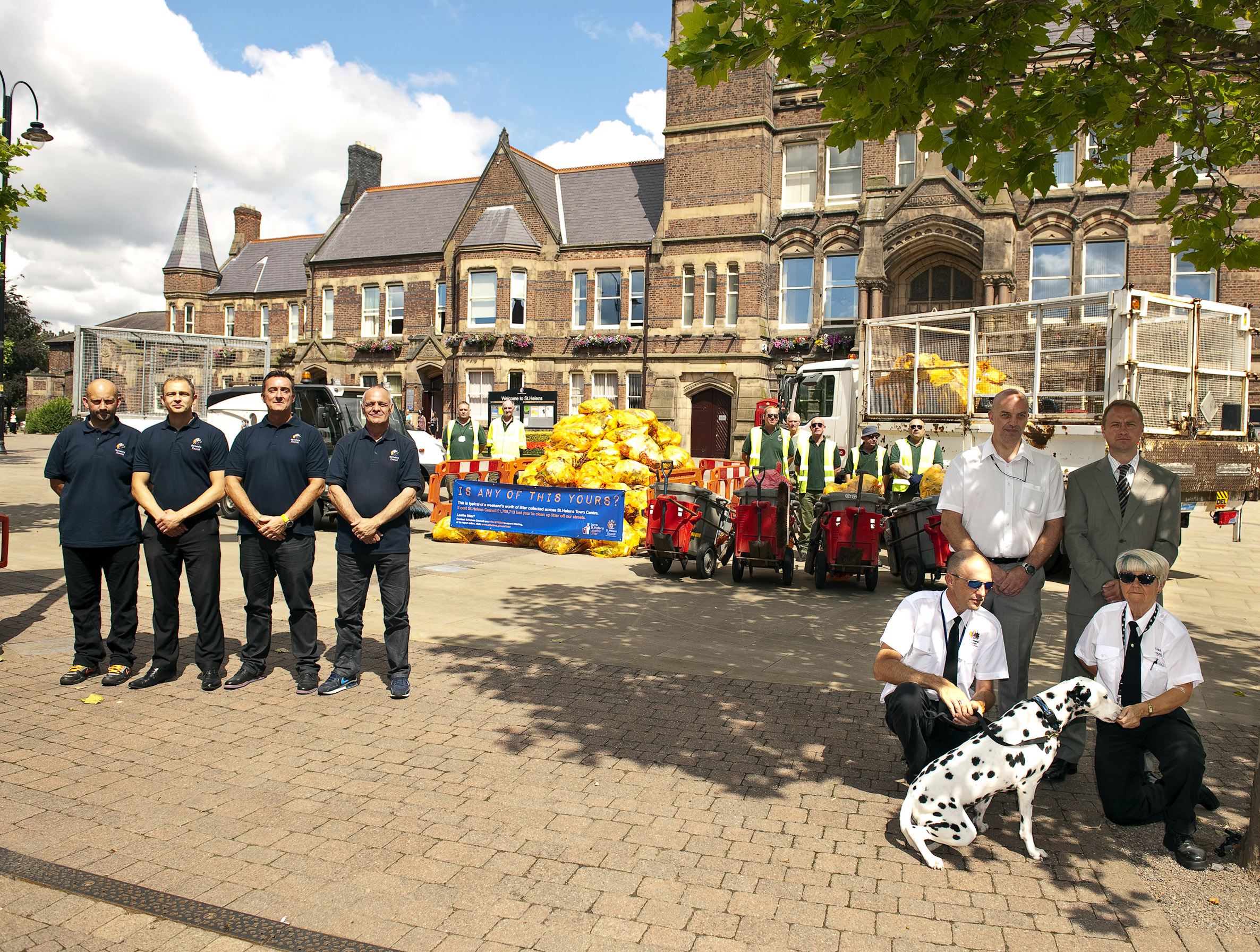 Messy affair – street cleaners and dog warden staff pictured with the mound of rubbish collected from just the town centre, dumped by litter bugs.