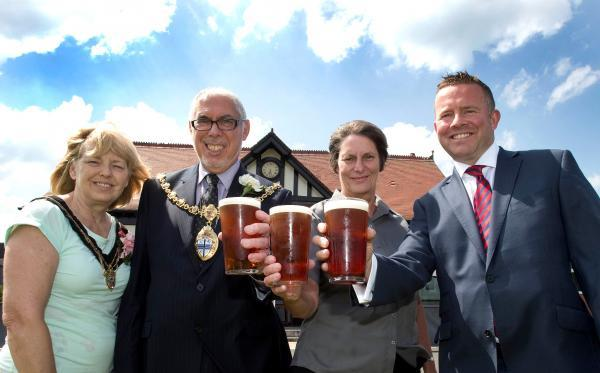 Raising their glasses: The mayor and mayoress of St Helens, Geoffrey and Carol Pearl (left) with Nor