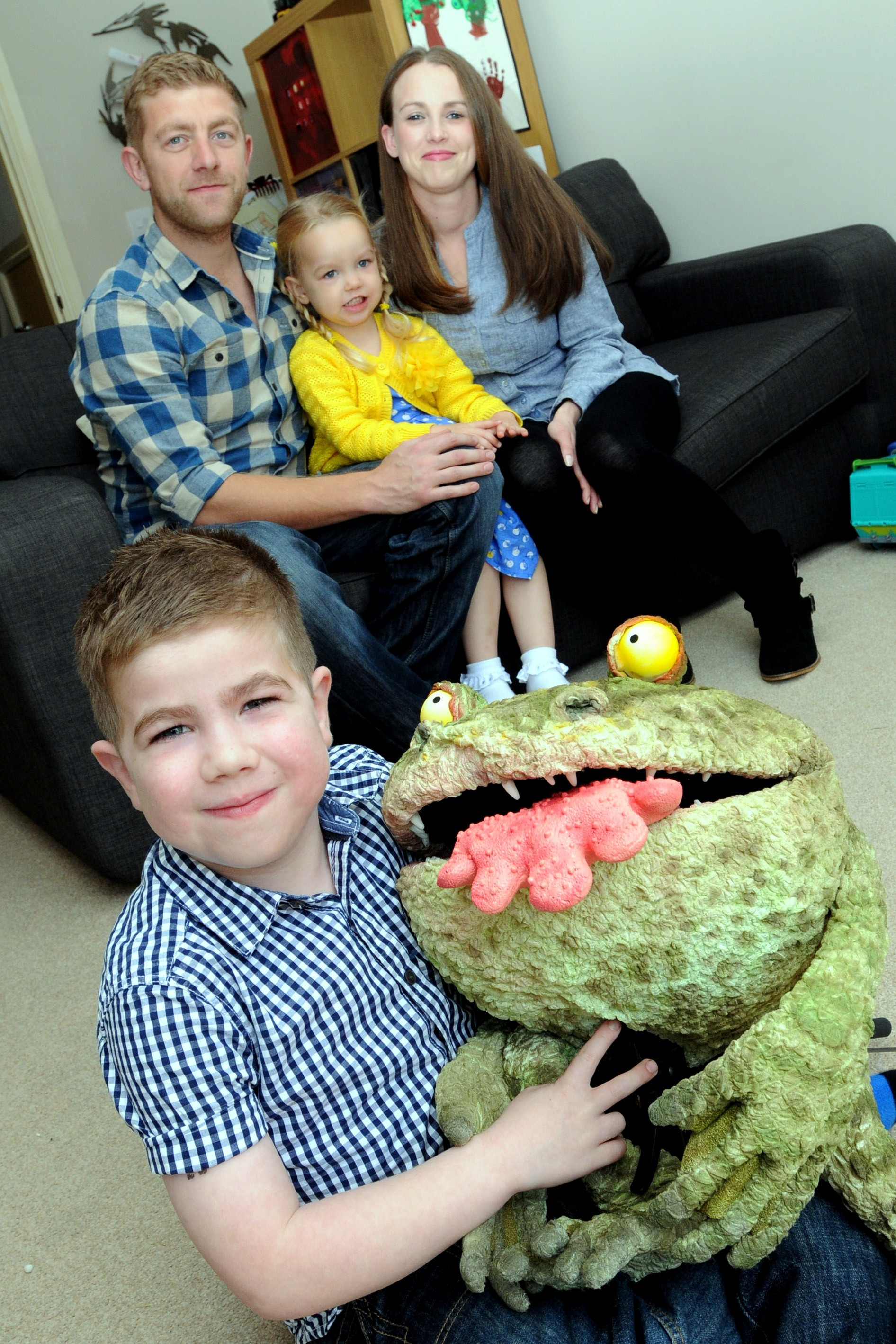 Clark and the 'Hand-tongued frog', with dad Mike, mum Katy and little sister Libby, aged three