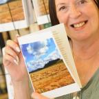 St Helens Star: Former Star journalist Sue Gerrard with her new book about the Crank Caverns