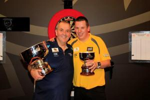 Gutsy Dave Chisnall edged out by Phil Taylor in SINGHA Beer Grand Slam of Darts final