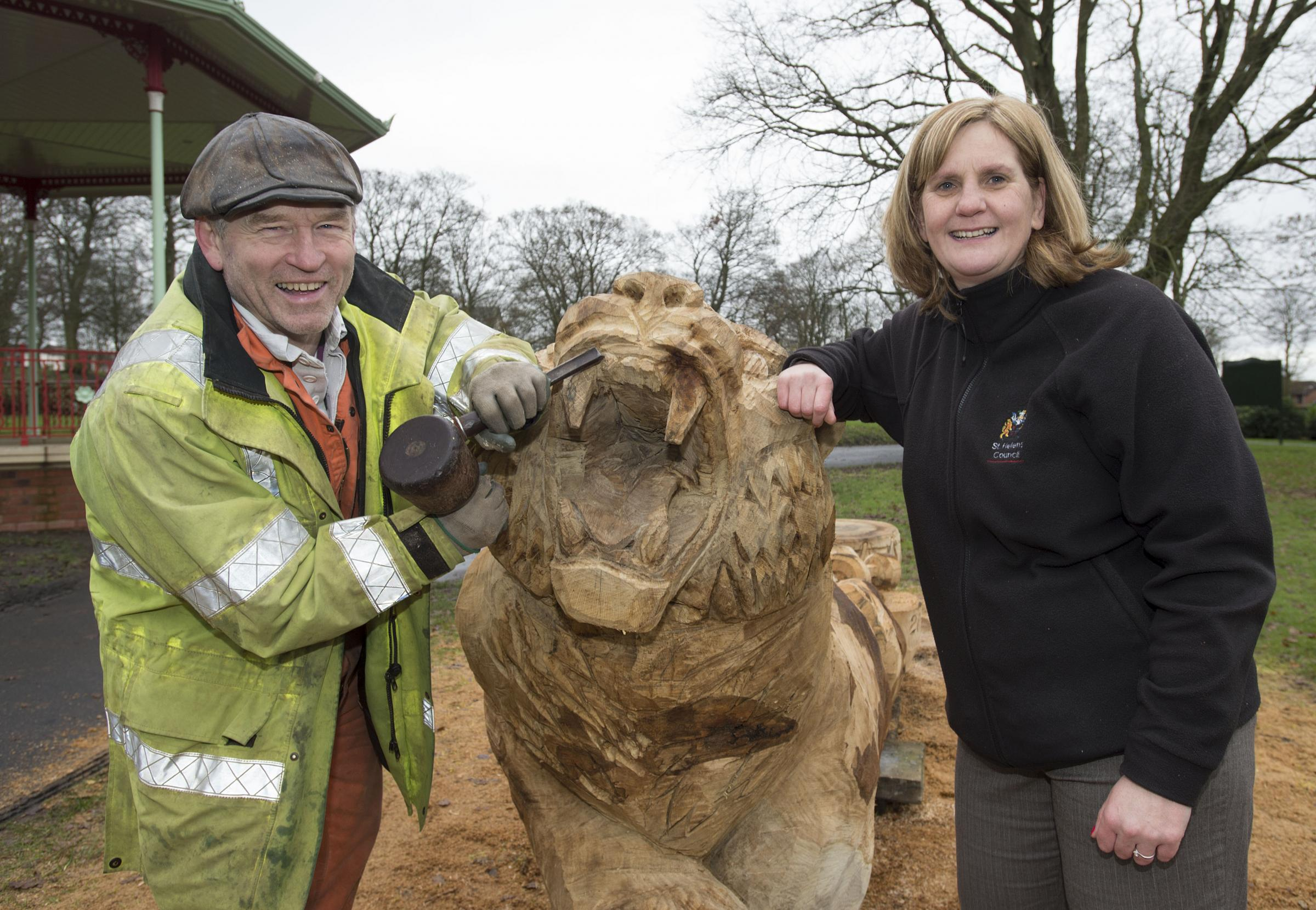 Sculptor Thompson Dagnall and Victoria Park officer Jill Barlow with the carving