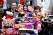 Customers at Royal Bank of Scotland help local children through Christmas toy appeal for Sure Start