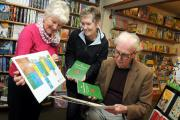 Former Cowley deputy head teacher Ken Taylor at one of the book signings at Wardleworths with Rita Allcock (left)