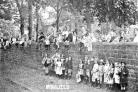 Children wait to watch the soldiers march past outside Rainhill School, now the Millennium Centre, in 1914