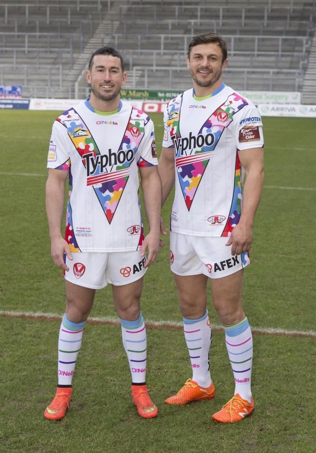 Saints captain Jon Wilkin and Shannon McDonnell modelling the shirt which was launched earlier this year