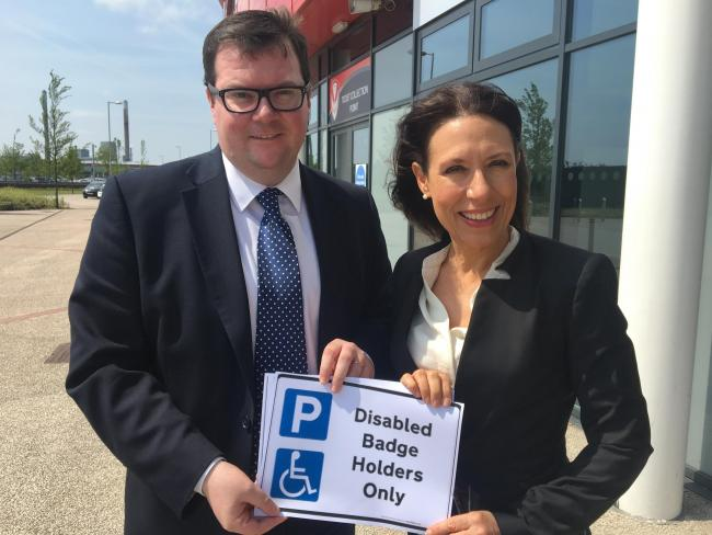 Shadow minister Debbie Abrahams with Conor McGinn MP outside Langtree Park