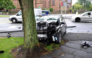 The car smashed into a tree on Dentons Green Lane, near the Gerrard pub