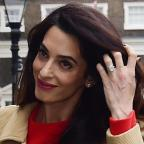 St Helens Star: Amal Clooney stunned in a gorgeous red dress as she gave a speech in London