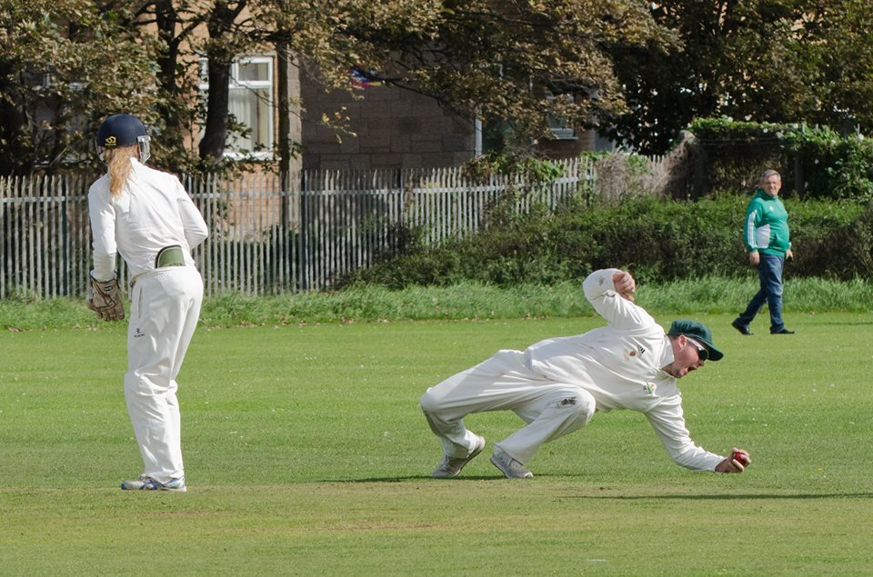 Paul Farrar taking a catch at Prestatyn