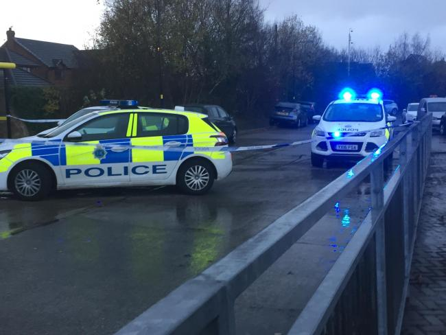 Police cordon off the scene at Lea Green railway station