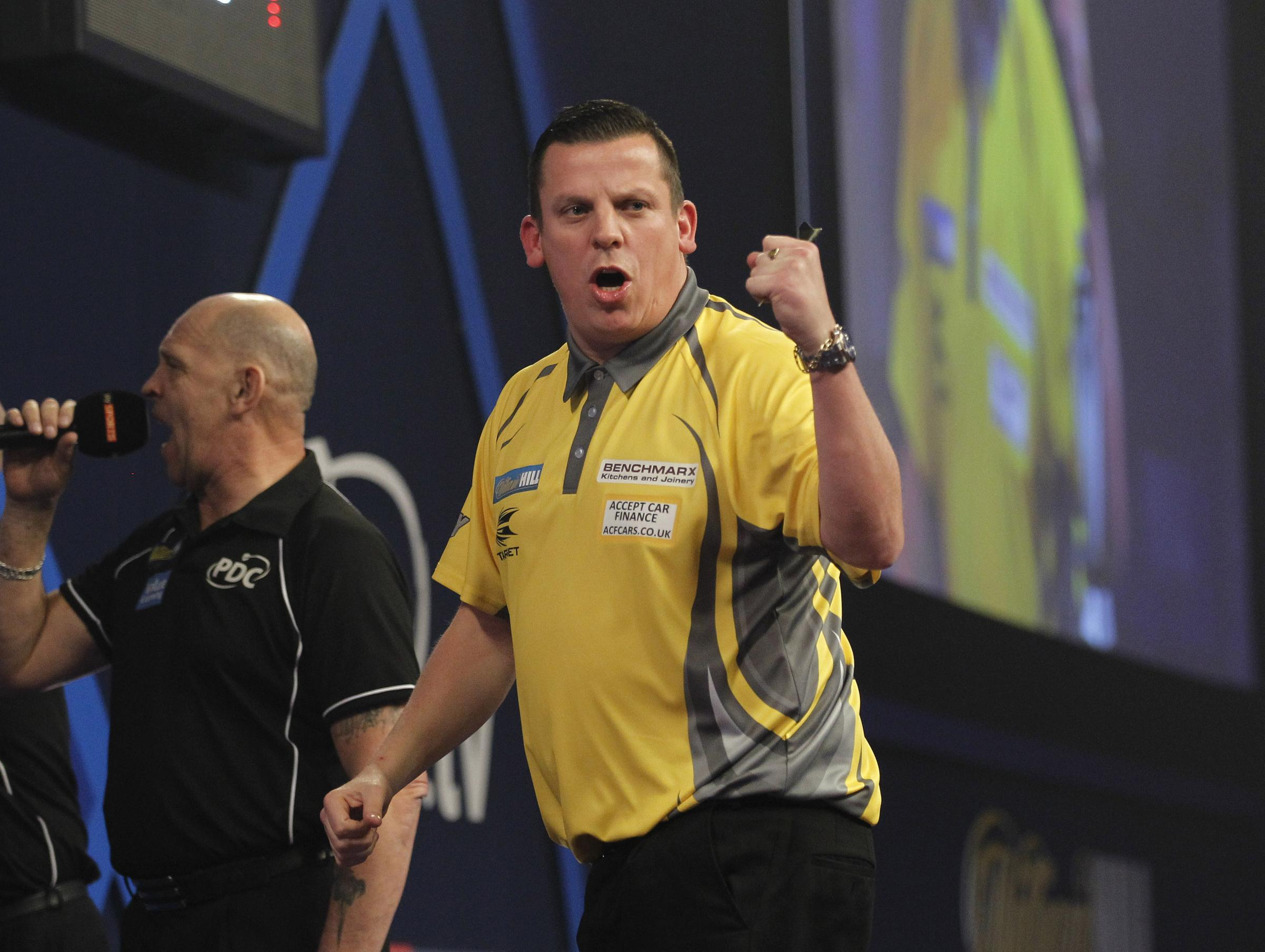 Dave Chisnall in action in last year's World Championships. Picture: Lawrence Lustig/PDC