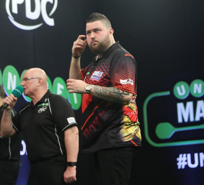Michael Smith shows his frustration at the Unibet Masters. Pictures: Lawrence Lustig